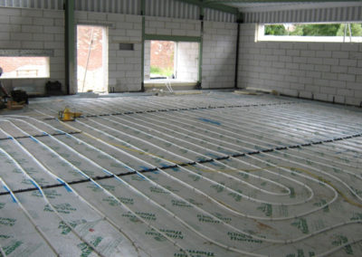 Office area underfloor heating installation in progress